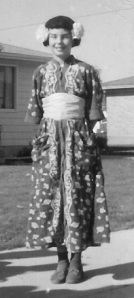 """Mom's """"duster"""" with a simple """"obi"""", recycled Sacajawea wig from a previous Halloween, Kleenex tissue flowers, eyebrow pencil and Voila - a Geisha girl."""