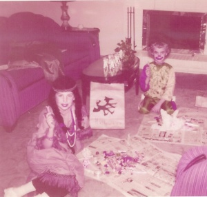 "Sacajewea dividing the bounty with my little sister Connie. Mom made my Indian dress.  I LOVED the wig! Connie wore one of those ""plastic"" costumes and ended up being the cutest little clown ever!!!"
